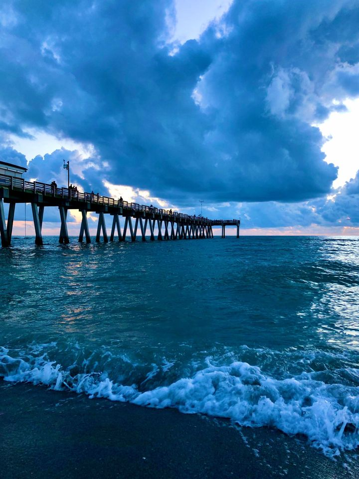 Sharkys Pier and Cloudy Sunset